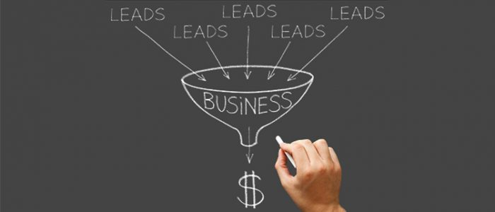 Chalkboard drawing of leads going into a business funnel and coming out as money